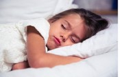 Portrait of a little girl resting in bed at home